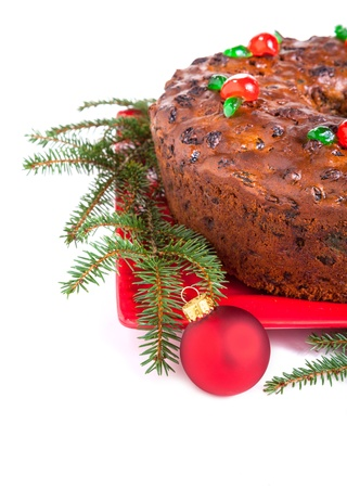 Traditional homemade Christmas fruitcake decorated with candied cherries, boughs and baubles Stock Photo - 21746416