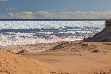 breaking up: Ice breaking up along Cavendish Beach, Prince Edward Island, Canada.