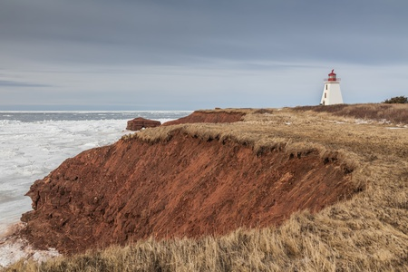 egmont: Winter view of sandstone cliffs and rock formations at the site of the Cape Egmont Lighthouse, Prince Edward Island. Stock Photo