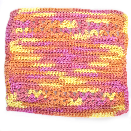 dishcloth: Handmade crocheted dishcloth made with different stiches and multicolored yarn.