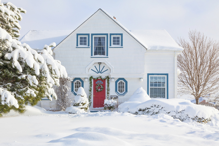 Traditional older North American house decorated for Christmas. Stock Photo