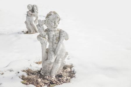 cherubs: Old garden cherubs in the winter garden.