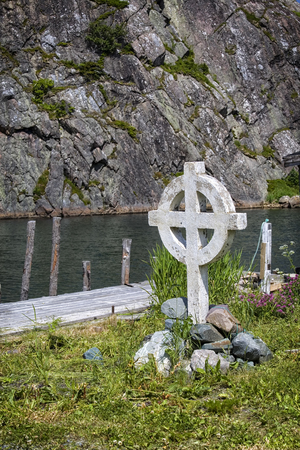 nfld: Celtic cross along the shore in Quidi Vidi which is part of St. Johns, Newfoundland, Canada. Stock Photo