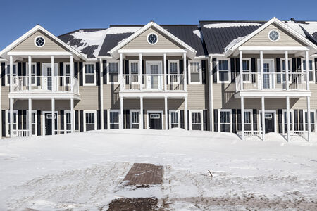 property development: New townhouses under a layer of freshly fallen snow.