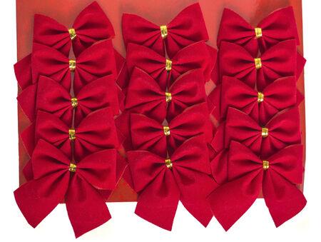 backing: A mass of velvet like Christmas bows on a cardboard backing sheet.