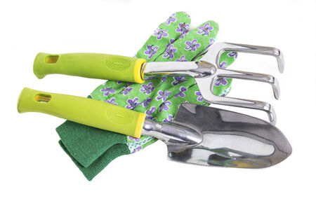 Garden gloves, trowel and hand rake on white. photo