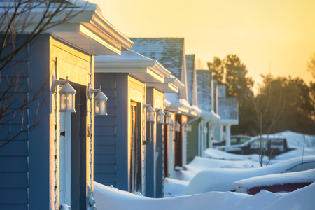 blanketed: Sunrise on a neighborhood blanketed in snow.