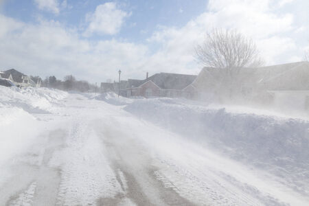blizzard: Poor visibility with strong winds blowing snow around during a snow storm in suburbia. Stock Photo