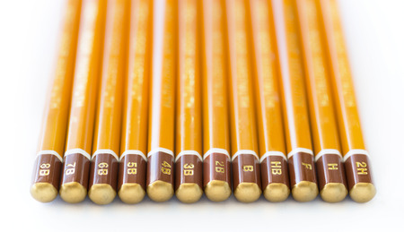 hardness: A collection of art graphite pencils of varying hardness. Stock Photo