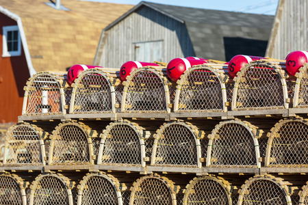 Piles of lobster traps on a wharf in rural Prince Edward Island, Canada. photo