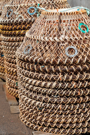 crab pots: Piles of crab pots on the wharf in rural Prince Edward Island, Canada