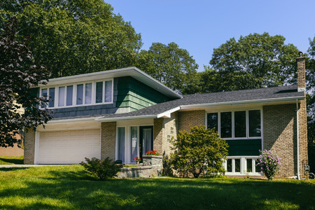 North America seventies era wooden split level home in suburbia