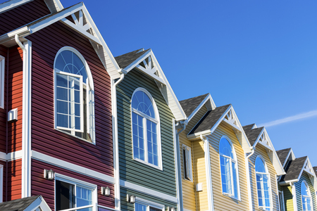 A row of colorful new townhouses or condominiums. photo