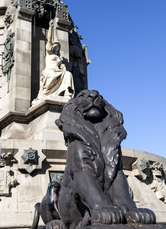 Lion statue located at the Columbus monument in Barcelona  Columbus monument is tall monument for Christopher Columbus at lower end of La Rambla, Barcelona, Spain  photo