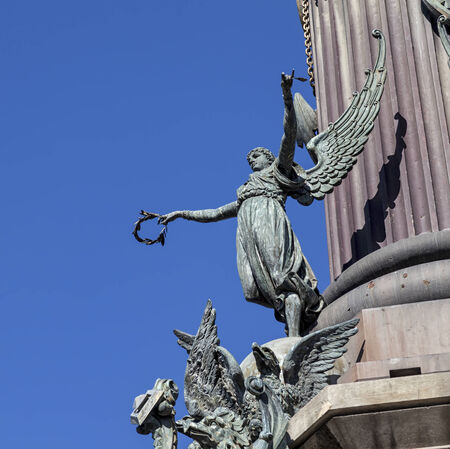 Winged figure on the Columbus monument in Barcelona  Columbus monument is tall monument for Christopher Columbus at lower end of La Rambla, Barcelona, Spain  photo