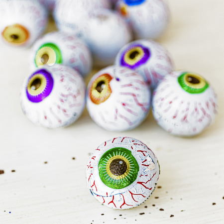 foil: Chocolate candy eyeballs for Halloween wrapped in foil. Stock Photo