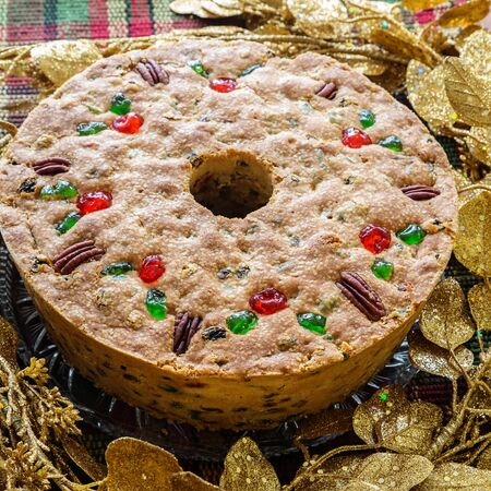 fruitcake: Traditional light fruitcake decorated with pecans and cherries.
