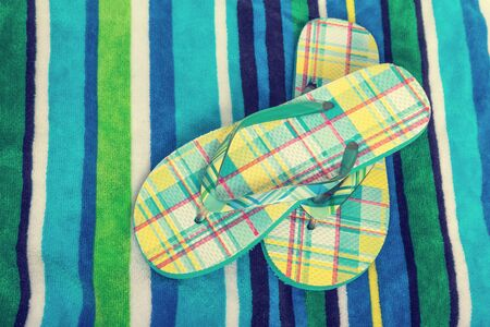 Beach towel and flip flops with a vintage effect.
