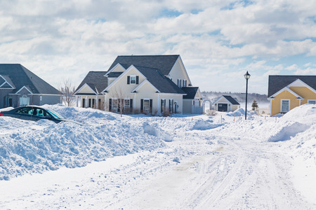 Piles of snow from plowed roads in the suburbs. Stock Photo