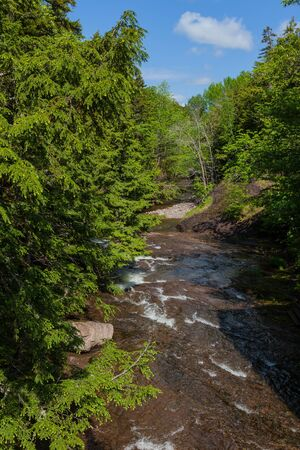 A river flowing through rural Nova Scotia, Canada. Stock Photo