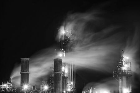 fumes: Fumes from an old oil plant . Stock Photo