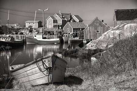 Sepia Peggys Cove, a small village on Nova Scotias coast. Stock Photo