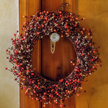 Christmas wreath made out of berries with a vintage feel. Stock Photo