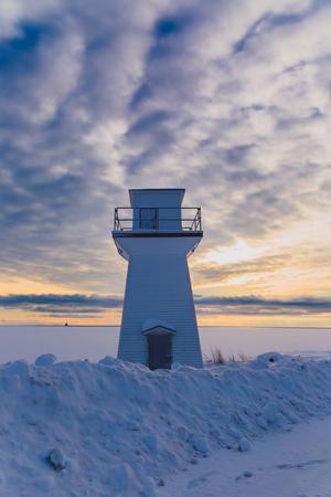 snowbank: Lighthouse or range light along the waterfront of Summerside, Prince Edward Island at sunset.