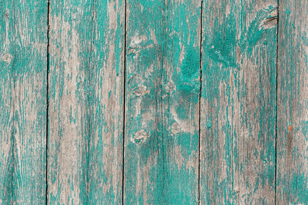 green background: Old wooden  barn board with a distressed surface. Stock Photo