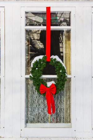Christmas wreath and garland decorating an older style home.