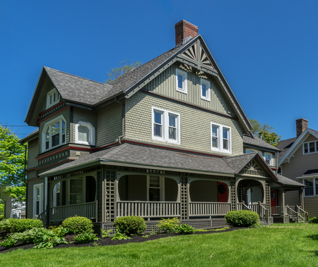Traditional older home with landscaped grounds. Stock Photo