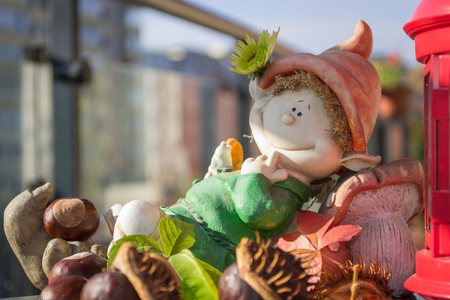 Small figurine representing a dwarf lying in the sun Stock Photo