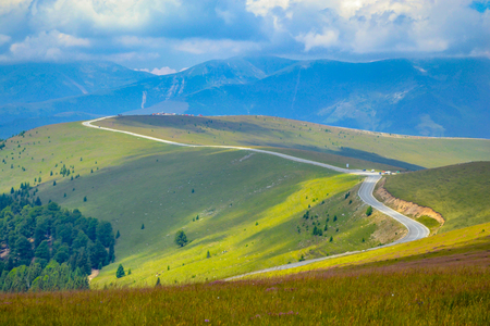Landscape with winding road in high mountains Stock Photo