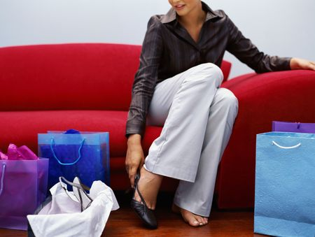 put on: Woman put on shoe Stock Photo