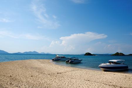 beauty full beach and the three speed boat