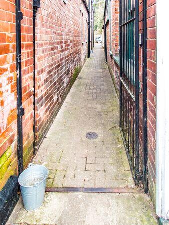 Tin Bucket in an Alleyway.