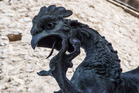 Close up view of iron dragons upper part head and neck. Statue in the old Trsat castle. Rijeka Croatia.