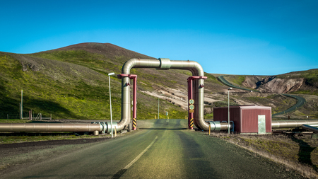 Interesting view of industrial pipe going over road on thermal power station near City of Reykjavik. Iceland, Europe.
