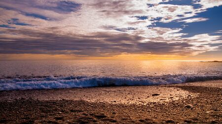 Panoramic view of beautiful colorful sunset landscape on black sand beach on Iceland. South Iceland in summer, Europe.