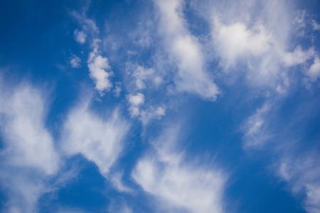 Fantastic soft fluffy white wind blurred clouds on blue sky. Use for background. Reklamní fotografie