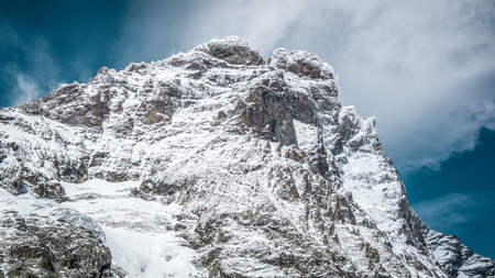 Close up view of the south face of the Matterhorn, blue sky with white clouds above. Summer in the Pennine Alps, Valle dAosta, Italy, Europe. Reklamní fotografie