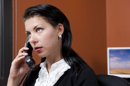 Un trabajador de la Oficina de la mujer en un entorno de Oficina