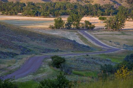 A twisting country road on a farm on the Canadian Prairie