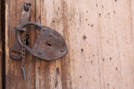 A rusty lock on a wooden gate Stock Photo