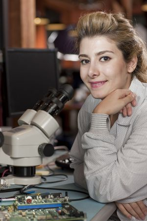 A female researcher looking into a microscope