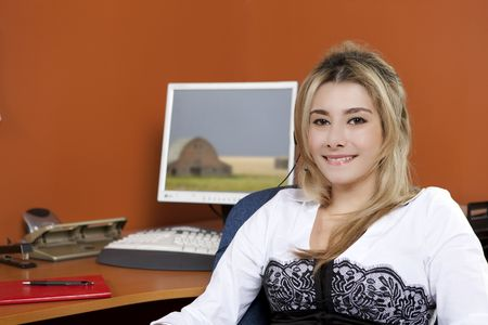 A female office worker in an office environment