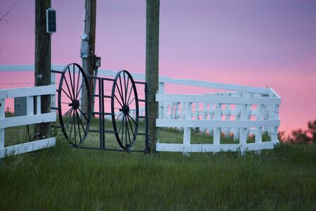 Sunset and fence on a horse farm