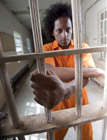 A black man with an afro making various faces and gestures inside a federal prison Stock Photo - 6649748