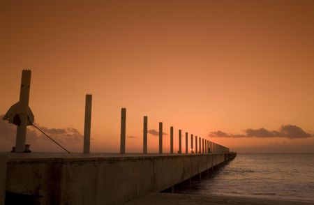 Watching the sun rise on the cruise ship dock in Playa del Carmen Mexico Stock Photo