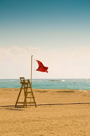 A lifeguard station flying the red flag on a beach in Spain. Stock Photo